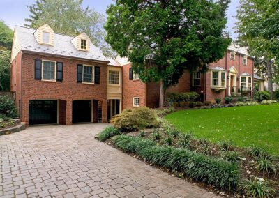 Addition from outside with driveway, brick exterior
