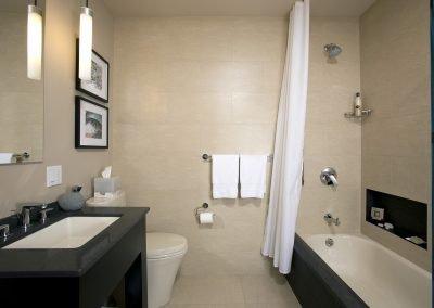 Bathroom with tub, vanity, toilet