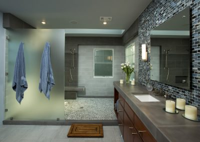 A bathroom with a very large shower