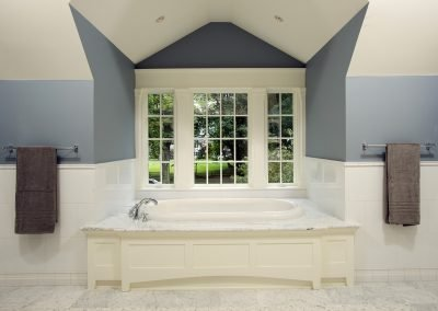 A tub next to windows