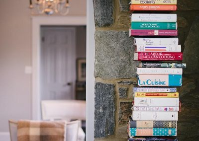 Books stacked next to a door