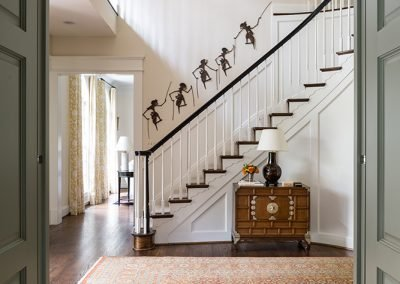 A doorway to the foyer with stairs