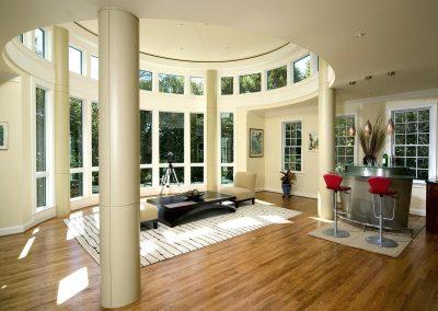 A circular sitting room with bar