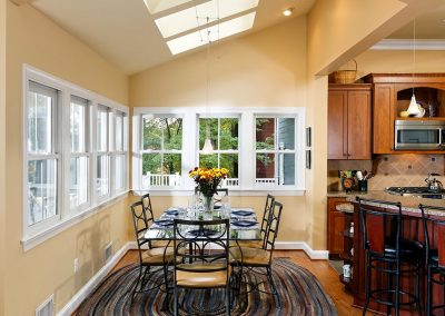 A dining room with windows and skylights