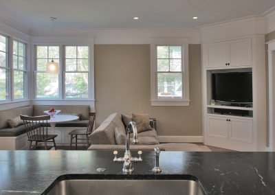 The view from the kitchen into the seating area of a rear addition