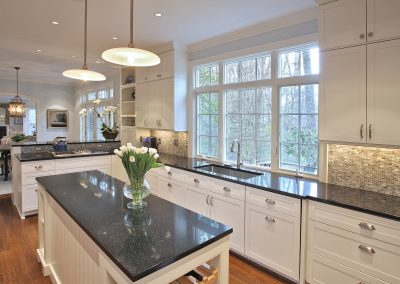 A remodeled kitchen with windows and an island