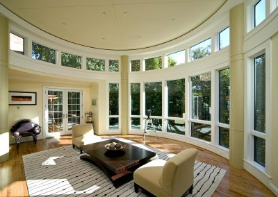 A circular sitting room with coffee table in middle