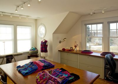 A craft studio with fabrics and a mannequin