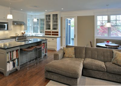 A seating area, breakfast nook and kitchen in a rear addition