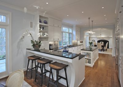 A kitchen that opens into the dining room
