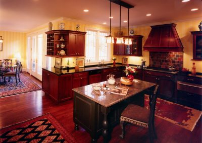 Remodeled kitchen with island and chair
