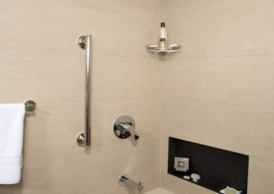 Bathtub with inset shelf and pull up bar