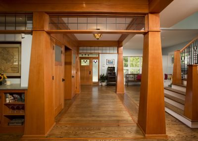An open ciruclation area in a remodeled home and stairs to the second story