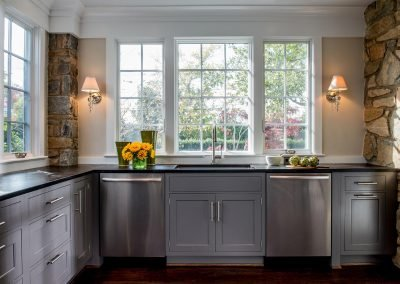 A sink and dishwasher in a remodeled kitchen