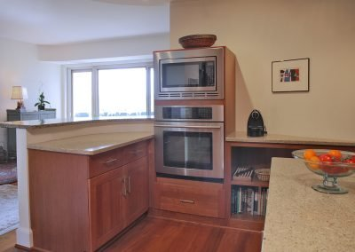 A kitchen with oven and microwave built-in