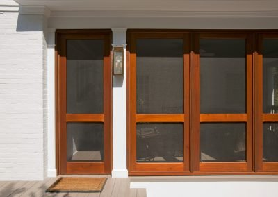 The screens of a porch addition