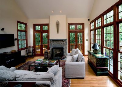 Living room addition with lot of windows, fireplace