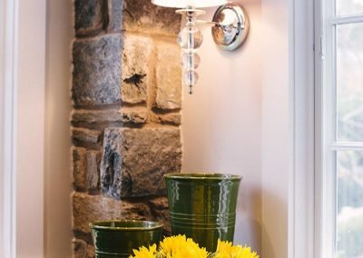 A lamp and vase in a remodeled kitchen