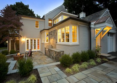 The porch, fire pit and outdoor grill of an exterior home remodel