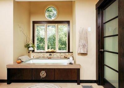 Bathtub next to windows