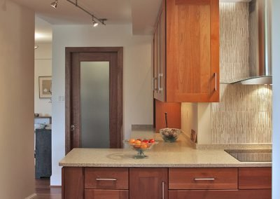 A remodeled kitchen with wood cabinets