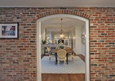 Brick interior entrance into dining room
