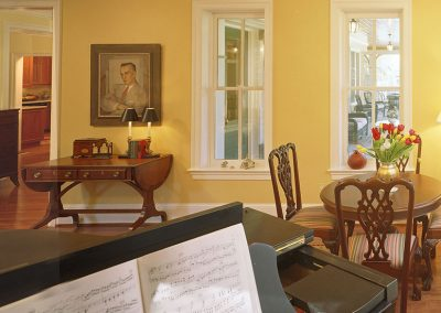 Interior of home with dining table and piano