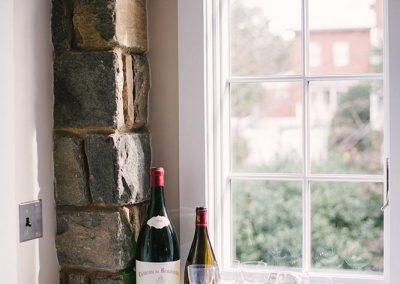 Wine next to a window