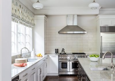 A remodeled kitchen with island, vent hood