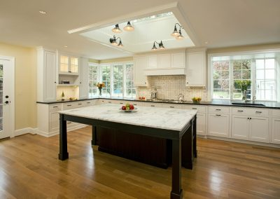 A remodeled kitchen with a large stonetop island