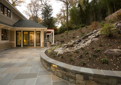 Landscaped hill next to entrance to dining room