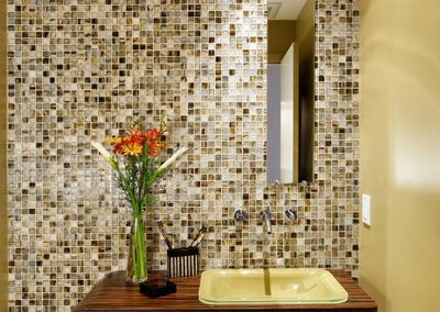Tile bathroom with thin mirror, wood shelving