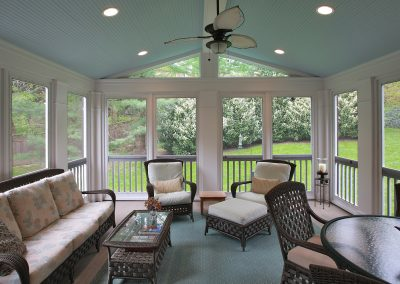 Porch with windowed walls, couch, seating area