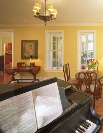 Living room with piano, chandelier